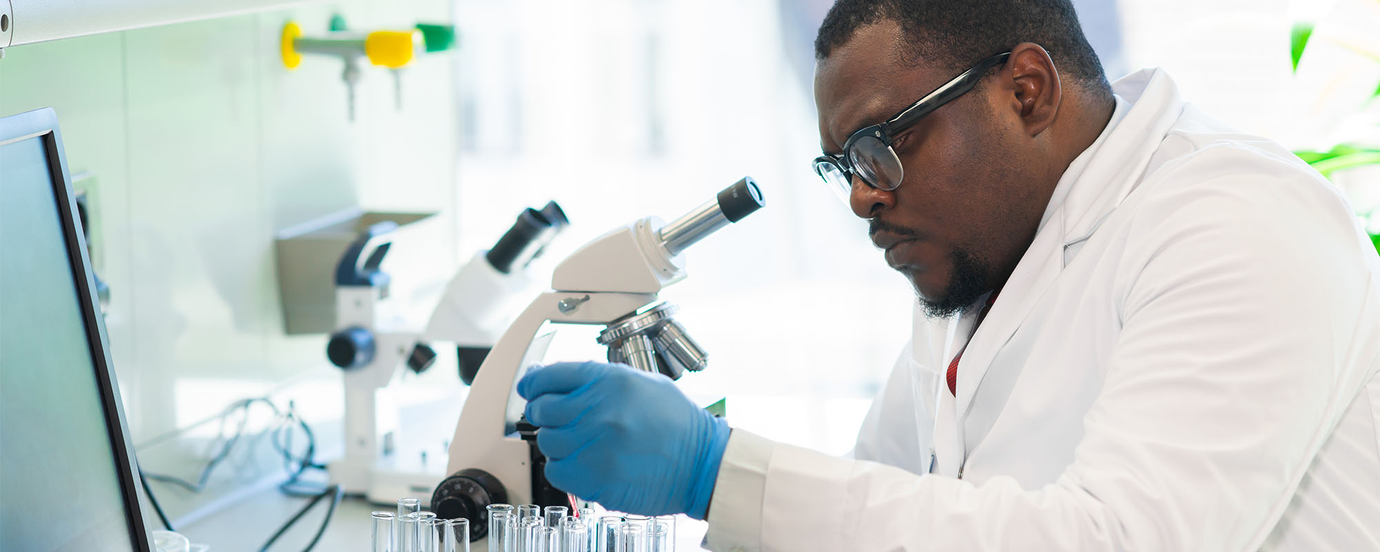 Photo of an African-American scientist working in lab.