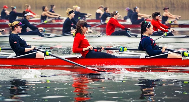 Merve, center in red, rows the Raritan with her Rutgers teammates.