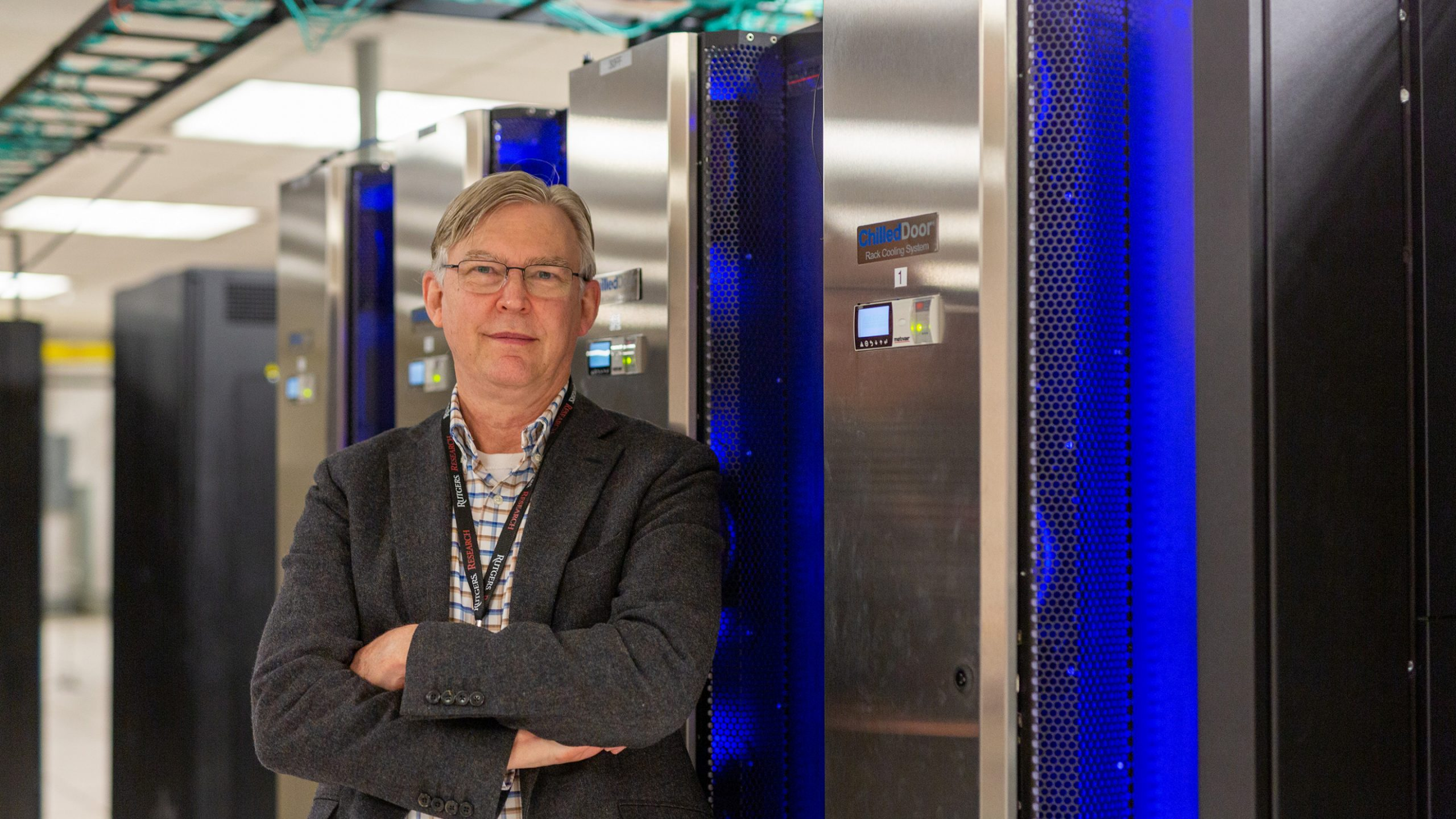 Barr von Oehsen, associate vice president of Rutgers' Office of Advanced Research Computing in front of the Amarel supercomputer which contributed to a historic crowdsourced computing effort to search for COVID-19 treatments