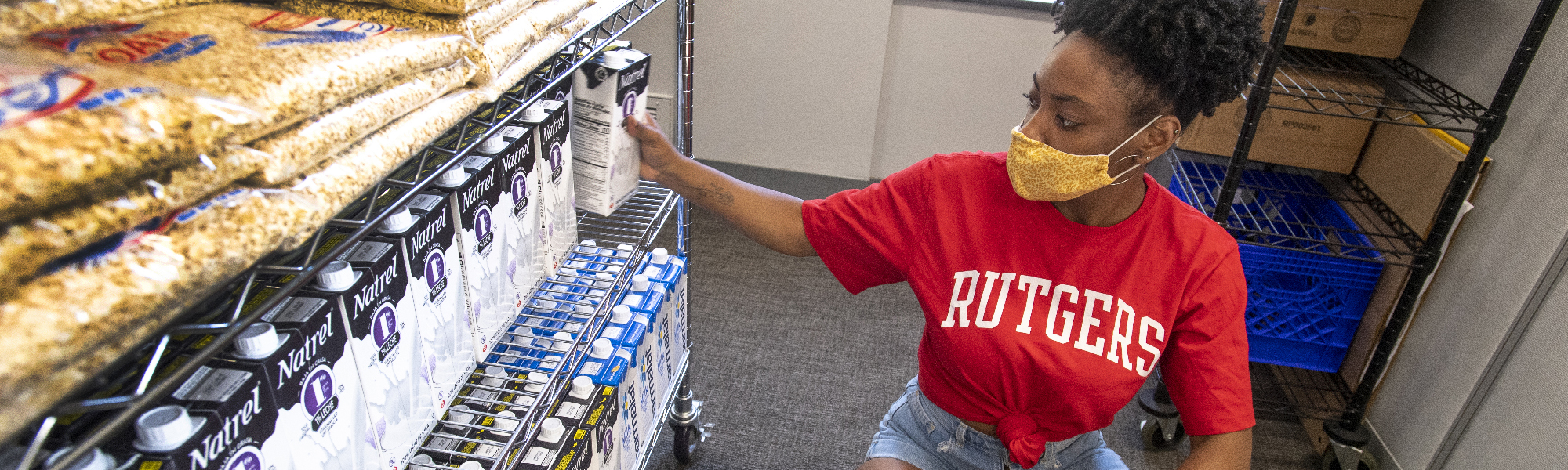 Deja Little (NCAS'21) adds groceries to shelves in the Newark Food Pantry, pantryRUN housed in Paul Robeson Campus Center in Newark 2020.