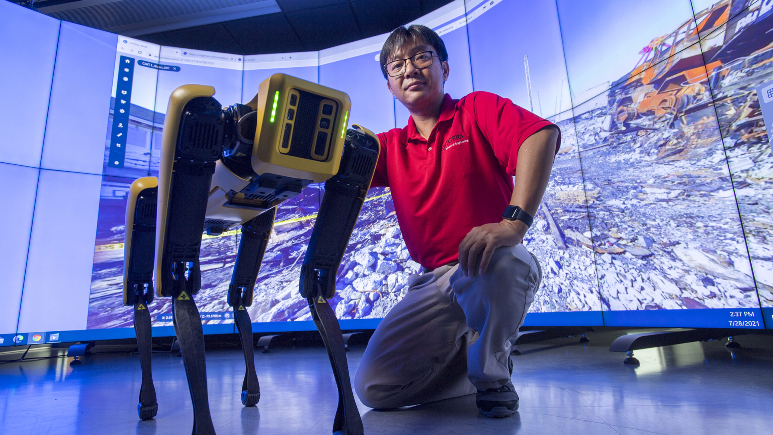 Jie Gong and a robotic dog