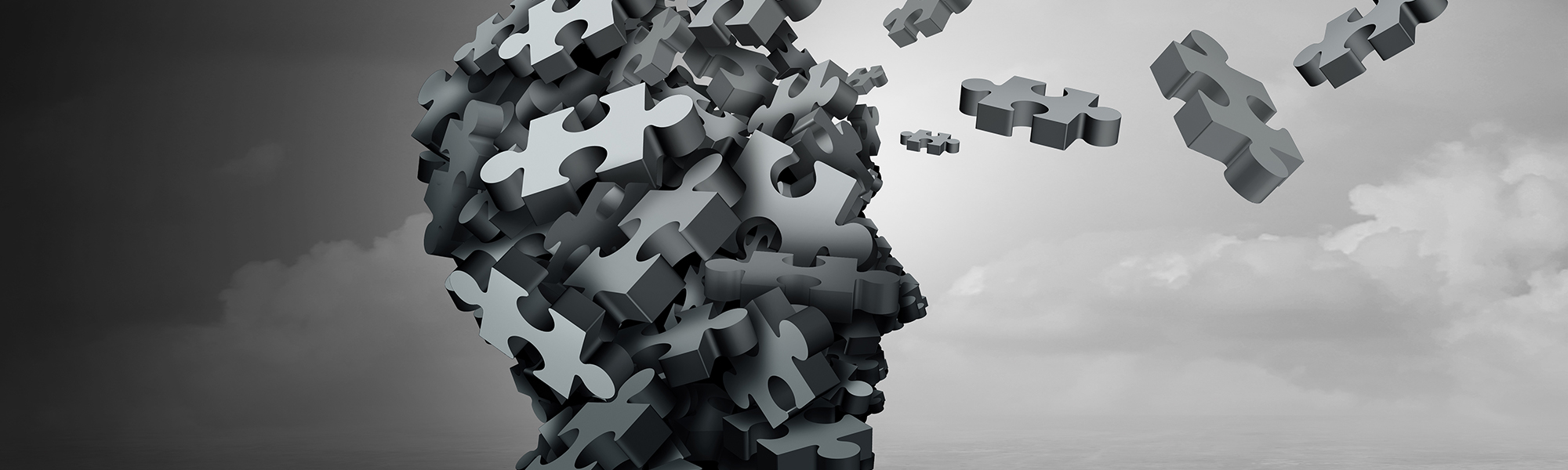 Parkinson disease and parkinson's disorder symptoms as a human head made of crumpled paper with a missing jigsaw puzzle representing elderly degenerative neurology illness in a 3D illustration.