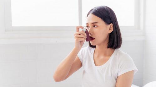asthma sufferer using an inhaler